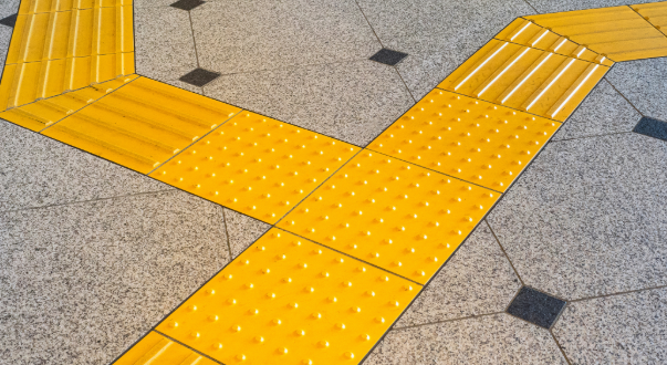 Tactile paving on a side walk.